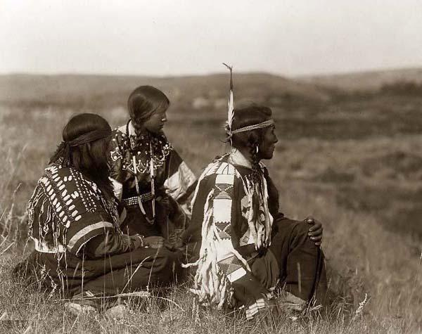 Indians Sitting in Grass